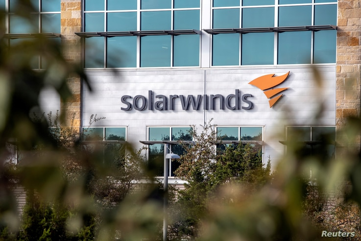 FILE PHOTO: The SolarWinds logo is seen outside its headquarters in Austin, Texas, U.S., December 18, 2020. REUTERS/Sergio…