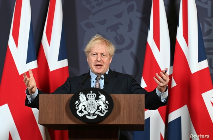British Prime Minister Boris Johnson holds a news conference in Downing Street on the outcome of the Brexit negotiations, in…