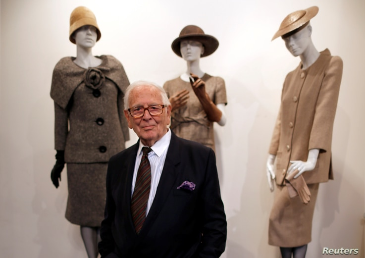 FILE PHOTO: French fashion designer Pierre Cardin poses in front of his 1954-1956-1957 fashion creations in his museum called …