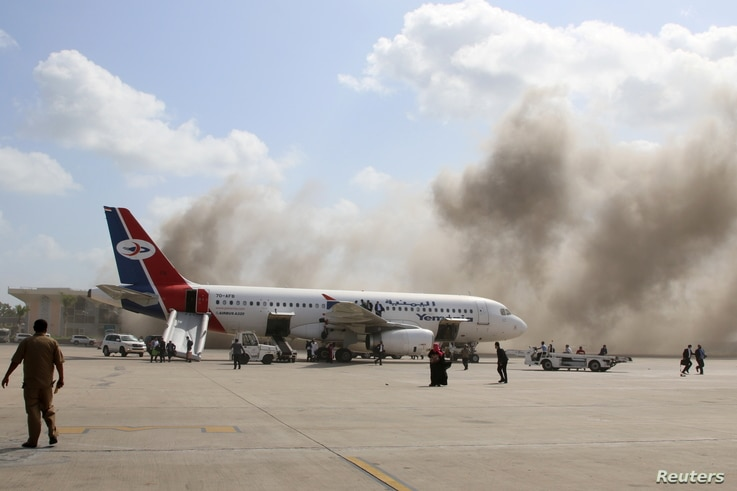 Dust rises after explosions hit Aden airport, upon the arrival of the newly-formed Yemeni government in Aden, Yemen December 30…
