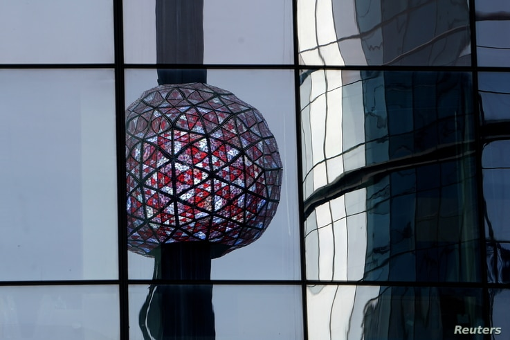 The Times Square ball is reflected in a nearby building as it is tested out for the media ahead of the New Year's celebration…