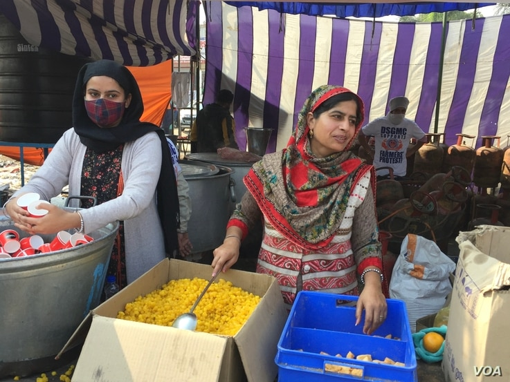 Women also help at the community kitchens that are a tradition in the Sikh faith.