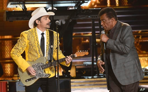 "Brad Paisley, left, and Charley Pride perform ""Kiss An Angel Good Morning"" at the 50th annual CMA Awards at the Bridgestone…"