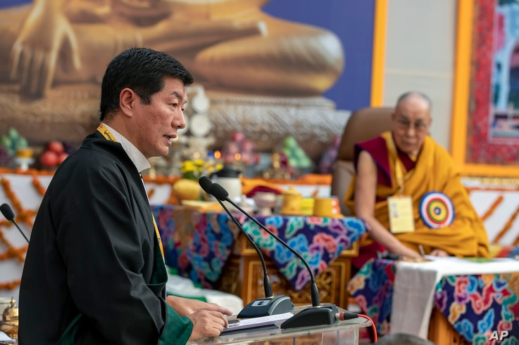 Tibetan spiritual leader the Dalai Lama, right, listens to President of the Tibetan government-in-exile Lobsang Sangay, left,…