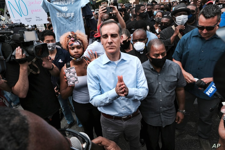 Los Angeles Mayor Eric Garcetti arrives to appeal to Black Lives Matter protesters in downtown Los Angeles on June 2, 2020.