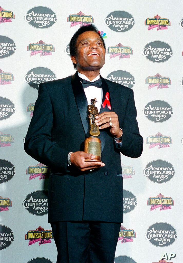 FILE - In this May 3, 1994 file photo, country singer Charley Pride poses with the Pioneer Award he received at the 29th…