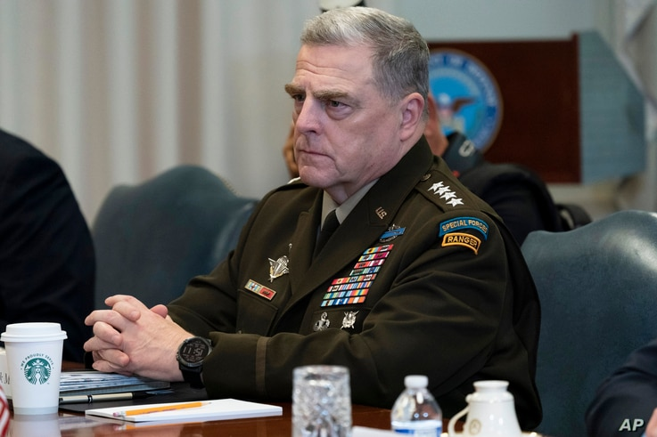FILE - In this Sept. 22, 2020, file photo Joint Chiefs Chairman Gen. Mark Milley listens before a meeting with Secretary of…
