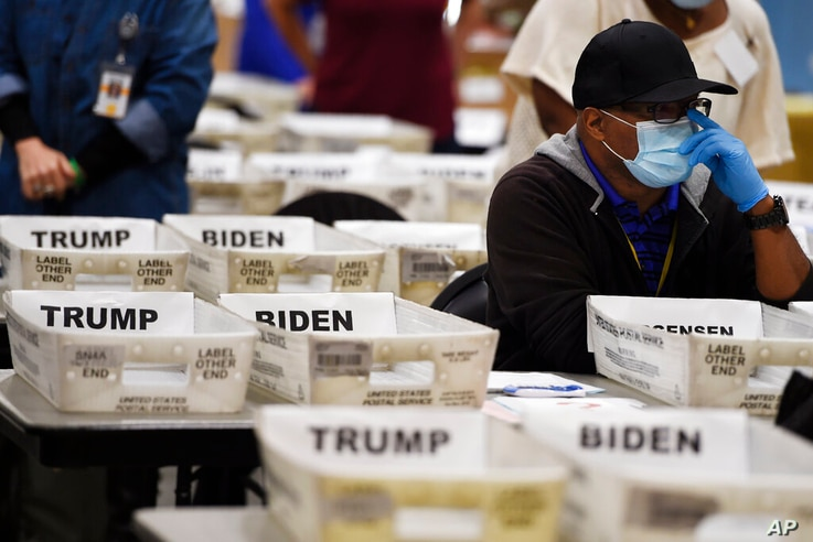 Cobb County Election official sort ballots during an audit, Friday, Nov. 13, 2020, in Marietta, Ga. (AP Photo/Mike Stewart)