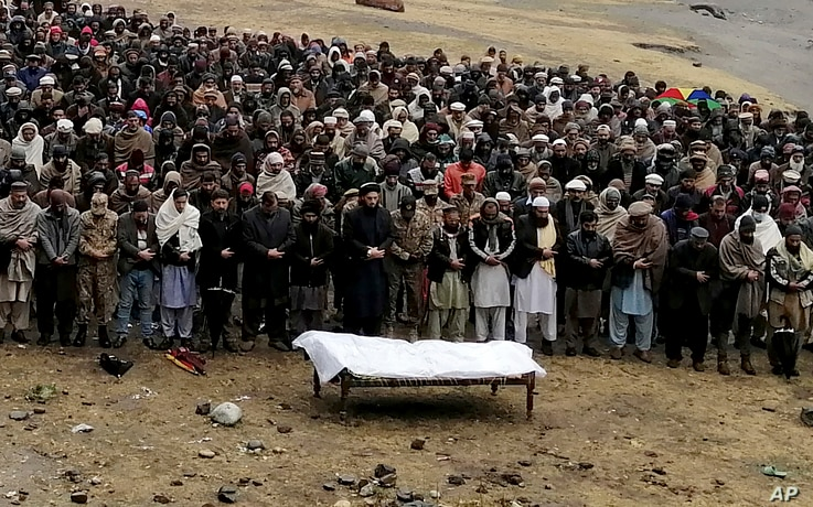 Pakistani Kashmiris attend a funeral prayer of a man, who was reportedly killed by cross border shelling from Indian troops, in…