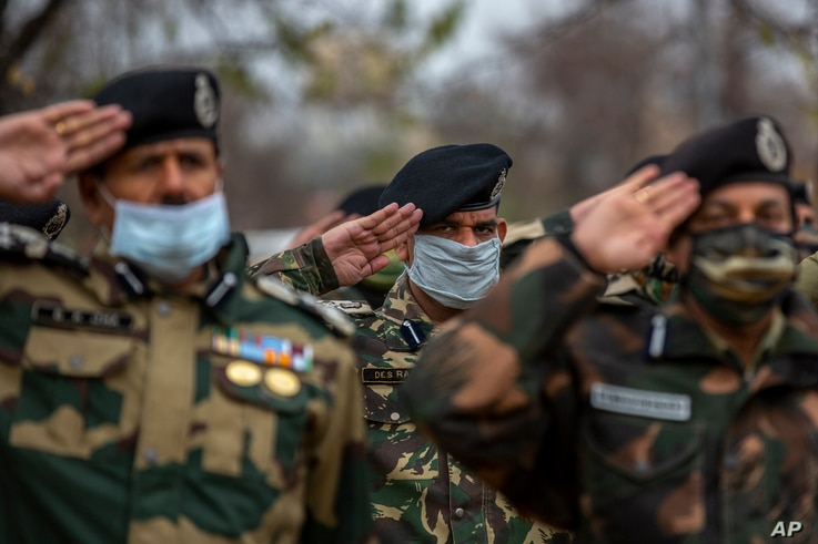 India Border Security Force (BSF) soldiers salute as they pay respect to their colleague killed during Friday's clash with…