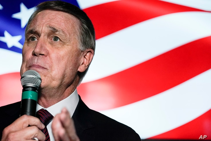 FILE - In this Friday, Nov. 13, 2020 file photo, candidate for U.S. Senate Sen. David Perdue speaks during a campaign rally, in...