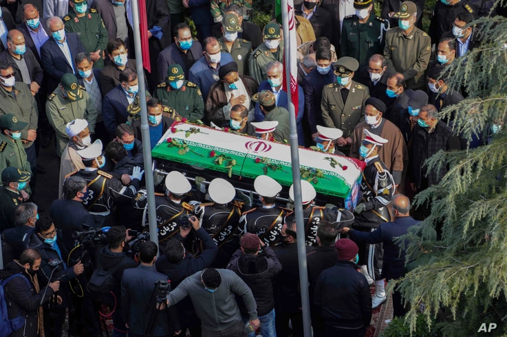 Military personnel carry the coffin of Mohsen Fakhrizadeh, an Iranian scientist killed on Friday, at a funeral ceremony in Tehran, Nov. 30, 2020.