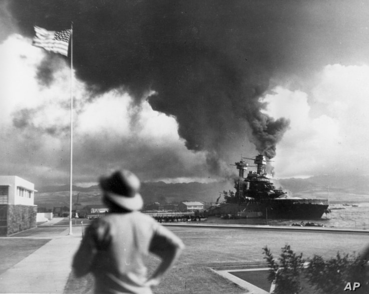 FILE - American ships burn during the Japanese attack on Pearl Harbor, Hawaii, in this Dec. 7, 1941 file photo.