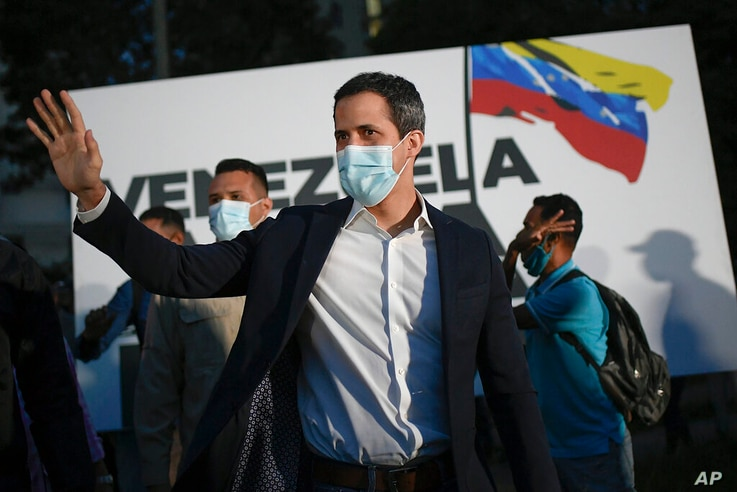 """FILE - In this Nov. 12, 2020, file photo, opposition leader Juan Guaido arrives to the """"Venezuela raises its voice"""" campaign…"""