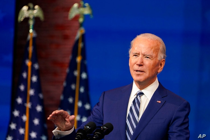 President-elect Joe Biden speaks during an event to announce his choice of retired Army Gen. Lloyd Austin to be secretary of…