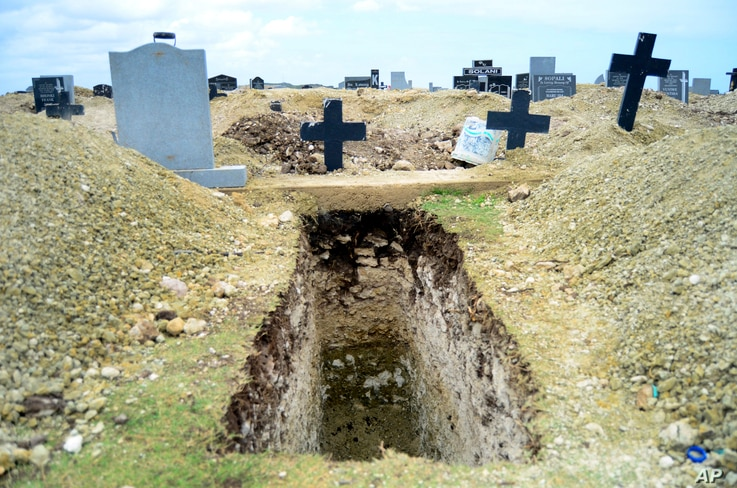 A freshly-dug grave sits at the Motherwell Cemetery in Port Elizabeth, South Africa, Friday, Dec. 4, 2020. Health Minister…
