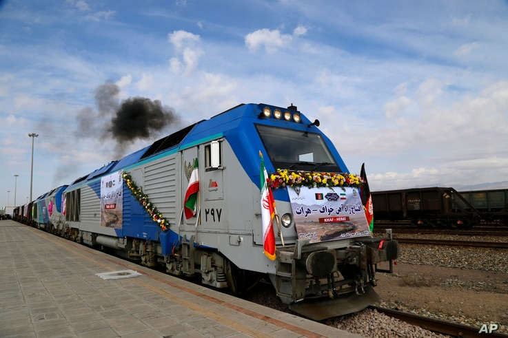 A train moves during the inauguration of a 140-kilometer (90-mile) line running from eastern Iran into western Afghanistan, at a railroad station in Khaf, Iran, Dec. 10, 2020.
