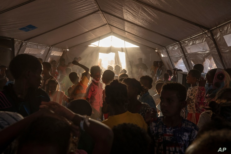 Tigray refugee children sing and dance inside a tent run by UNICEF for children's activities, in Umm Rakouba refugee camp.