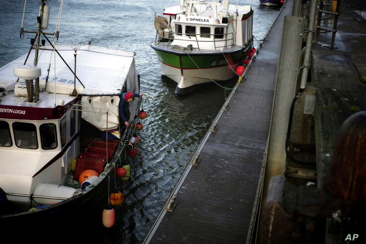 The Corentin-Lucas fishing boat arrives at the port of Boulogne-sur-Mer, northern France, Thursday, Dec. 10, 2020. Fishing…