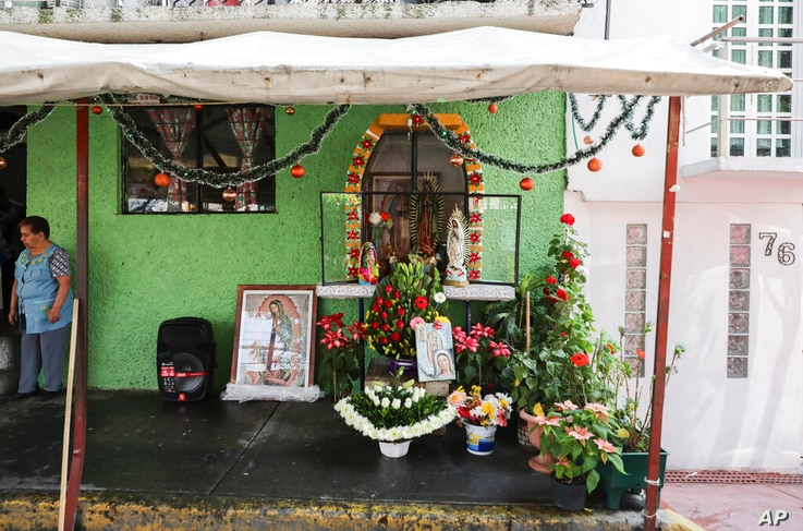 A makeshift altar honors the Virgin of Guadalupe outside a home in a neighborhood of Mexico City, Saturday, Dec. 12, 2020. For…