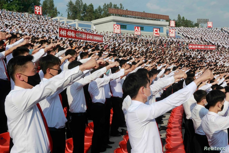 FILE - In this June 6, 2020 file photo, North Korean students stage a rally to denounce South Korea following that defectors…