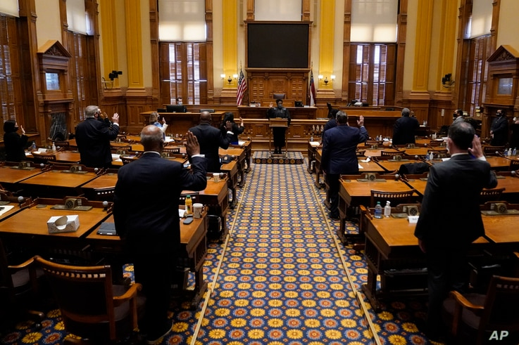 Members of Georgia's Electoral College are sworn in before casting their votes at the state Capitol, Monday, Dec. 14, 2020, in…