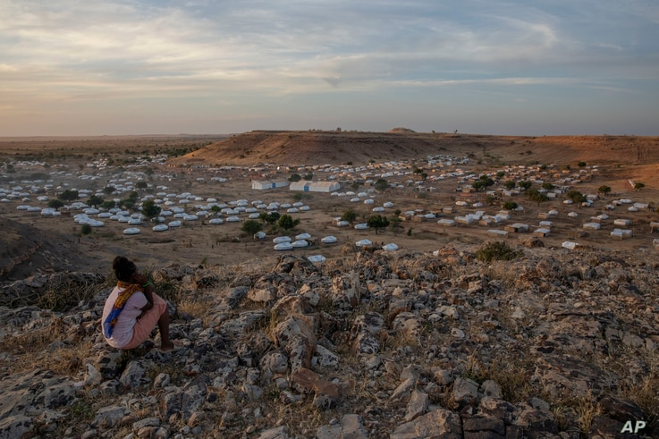 A Tigray girl sits atop a hill overlooking the Umm Rakouba refugee camp, hosting people who fled the conflict in the Tigray…
