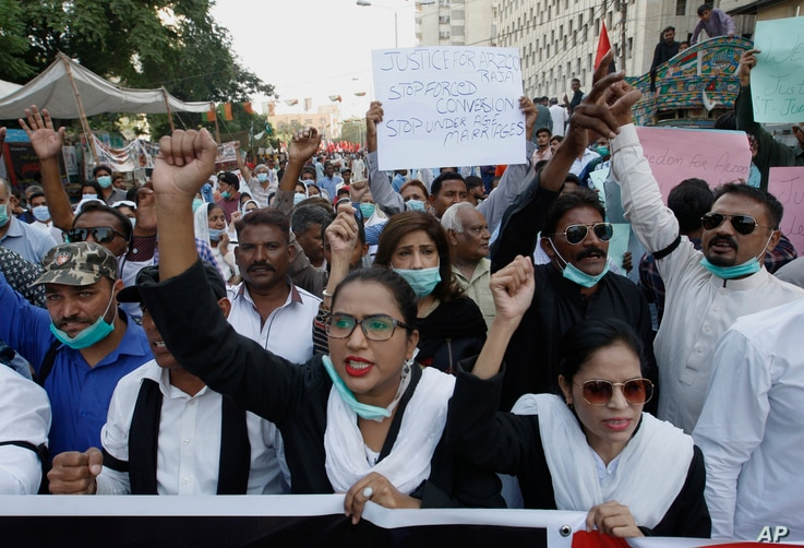 Pakistani Christians protest against child marriage and forced conversion, in Karachi, Pakistan, Nov. 8, 2020. Rights groups…