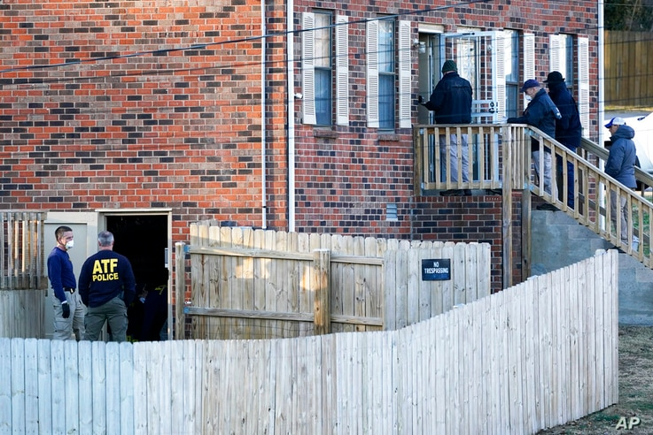 FBI and ATF agents investigate a home Saturday, Dec. 26, 2020, in Nashville, Tenn. An explosion that shook the largely deserted…