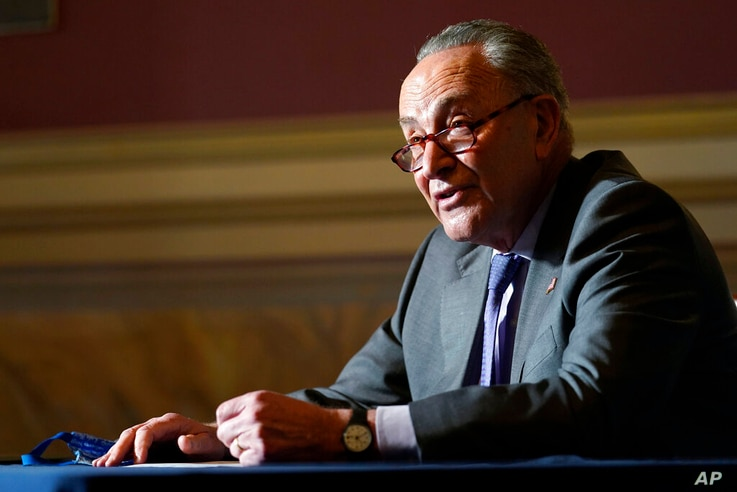 Senate Minority Leader Sen. Chuck Schumer of N.Y., speaks to reporters on Capitol Hill in Washington, Wednesday, Dec. 30, 2020,...