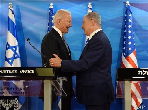 US Vice President Joe Biden and Israeli Prime Minister Benjamin Netanyahu shake hands while giving joint statements in the…