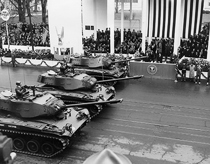 Tanks pass the inaugural parade reviewing stand of President Dwight D. Eisenhower on Jan. 21, 1957 in Washington. (Eisenhower Library)
