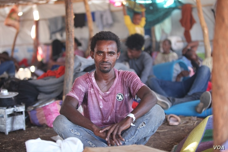 2332: Kafla Gabragargis, 25, fled Ethiopia and now lives in Um Rakouba camp in Sudan, having no contact with any of his friends or family on Dec. 10, 2020. (VOA/ Mohaned Bilal)