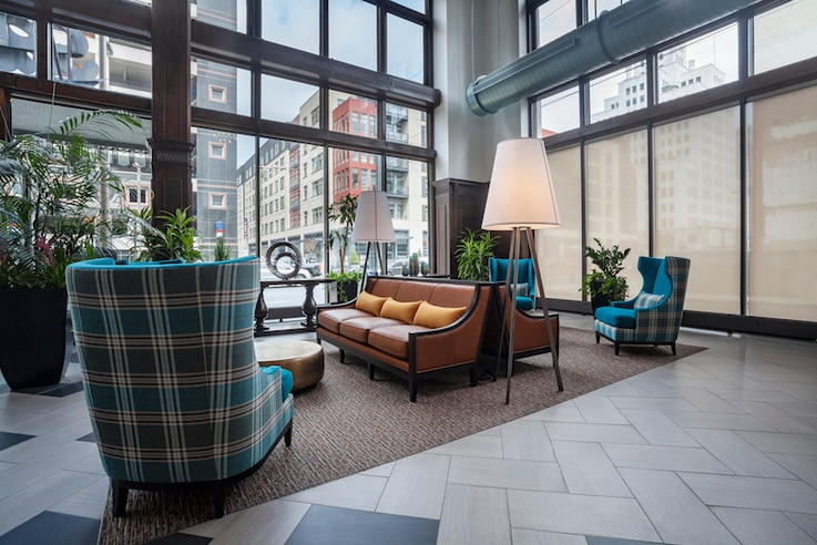 The Packard Motor Car Apartment Building's past history as a vehicle showroom is evident in its floor-to-ceiling windows, Philadelphia. (Courtesy Reinhold Residential)