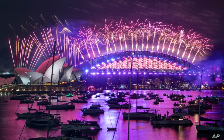 Fireworks explode over the Sydney Opera House and Harbour Bridge as New Year celebrations begin in Sydney, Australia, Dec. 31, 2020.