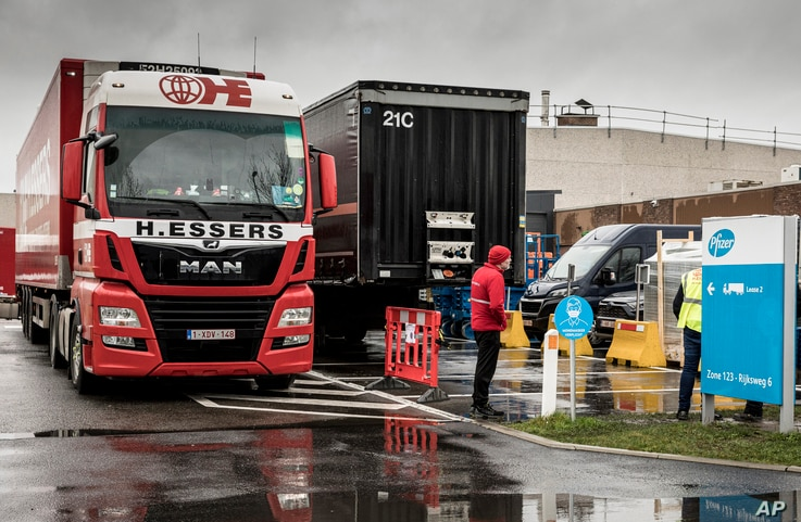 Trucks wait outside of loading bays at Pfizer Manufacturing in Puurs, Belgium, Dec. 21, 2020.