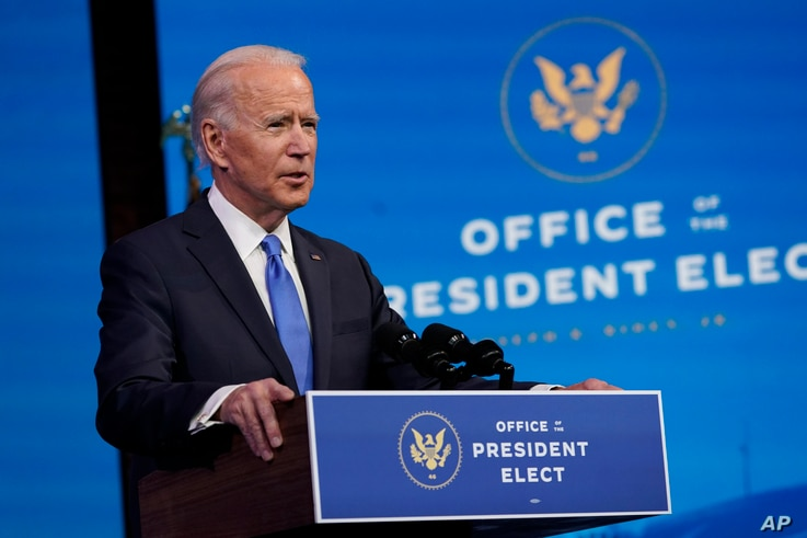 FILE - President-elect Joe Biden speaks after the Electoral College formally confirmed his election win, at The Queen theater in Wilmington, Delaware, Dec. 14, 2020.