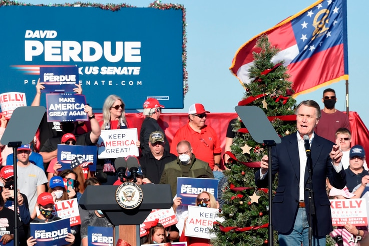 Georgia Sen. David Perdue speaks during a runoff campaign rally with Vice President Mike Pence, Dec. 10, 2020, in Augusta, Georgia.