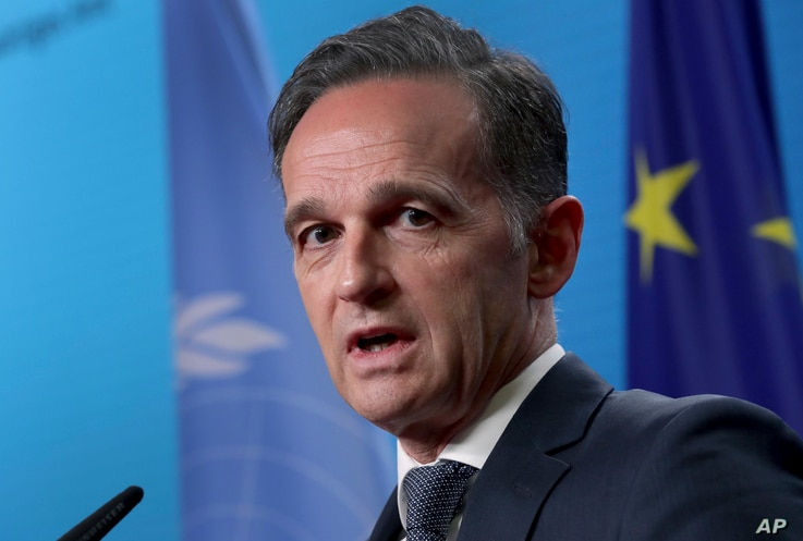 German Foreign Minister Heiko Maas addresses the media in Berlin, Dec. 17, 2020.