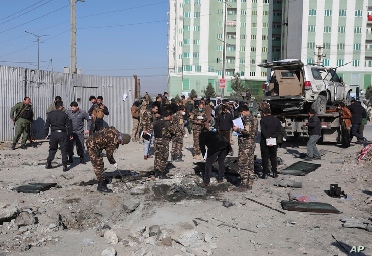Afghan security personnel investigate at the site of a bomb attack in Kabul, Afghanistan, Dec. 15, 2020. A bombing and a shooting attack on Tuesday in the Afghan capital of Kabul killed several people, including Kabul's deputy governor.