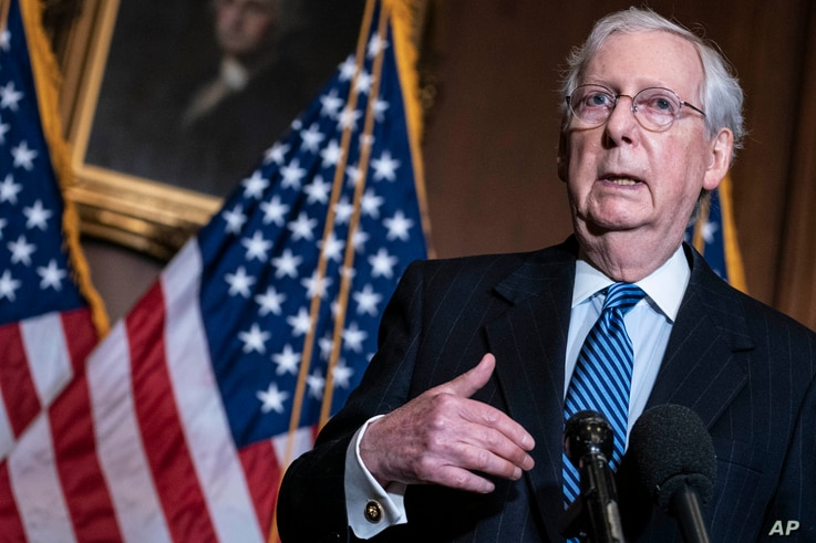 FILE - Senate Republican Majority Leader Mitch McConnell speaks during a news conference at the Capitol in Washington, Dec. 8. 2020.
