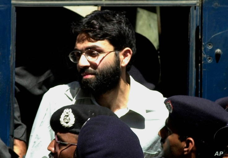 FILE- Ahmed Omar Saeed Sheikh, the alleged mastermind behind Wall Street Journal reporter Daniel Pearl's kidnap-slaying, appears at the court in Karachi, Pakistan, March 29, 2002.