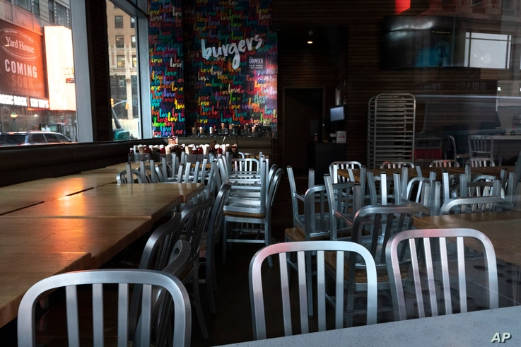 FILE - A restaurant closed for indoor dining to curb the spread of COVID-19 is seen in New York City, Dec. 15, 2020.