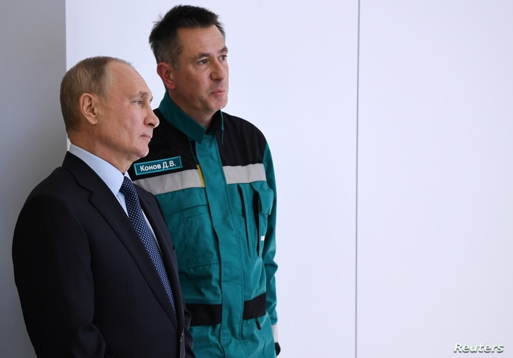 FILE - Russian President Vladimir Putin speaks with Chairman of the Management Board of the Sibur company Dmitry Konov as they visit a plant in Tobolsk, Russia, Dec. 1, 2020. (Sputnik/Alexei Nikolsky/Kremlin via Reuters)