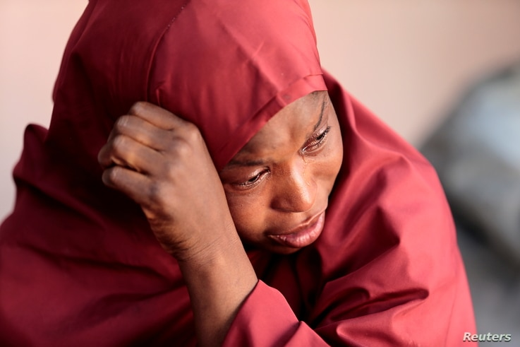 The mother of Muhammad Bello, one the students who was abducted by gunmen, reacts in Kankara, in northwestern Katsina state, Nigeria, De. 14, 2020.