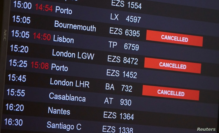 Flights from Britain are announced canceled at Cointrin airport, the day the Swiss government imposed a 10-day quarantine for travelers who have entered from Britain, during the outbreak of the COVID-19 in Geneva, Switzerland, Dec. 21, 2020.
