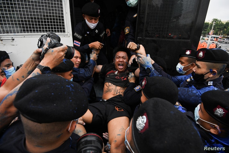 """FILE - Police detain pro-democracy protester Jatupat """"Pai Dao Din"""" Boonpattararaksa  during a mass rally to call for the ouster of Prime Minister Prayuth Chan-ocha's government and reforms in the monarchy, in Bangkok, Thailand, Oct. 13, 2020."""