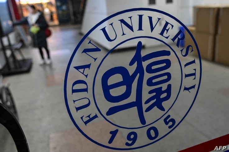 In this picture taken on December 18, 2019, a Fudan University sign is seen on the campus in Shanghai. - One of China's top…