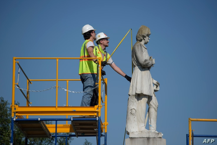 Houston city workers remove a statue of confederate soldier Dick Dowling from Hermann Park on June 17, 2020 in Houston, Texas. ...