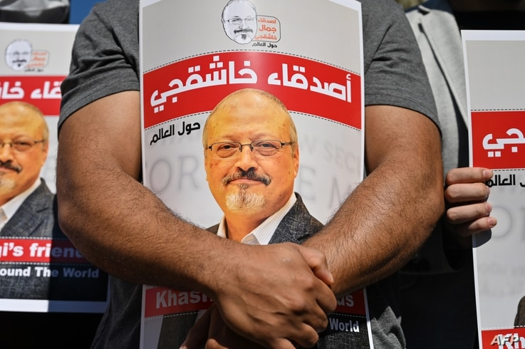 Friends of murdered Saudi journalist Jamal Khashoggi hold posters bearing his picture as they attend an event marking the second-year anniversary of his assassination in front of Saudi Arabia Istanbul Consulate, on Oct. 2, 2020.
